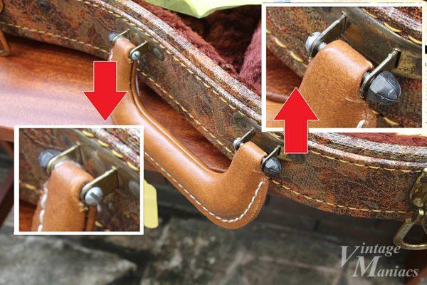 ネジで固定されたハードケースのハンドル