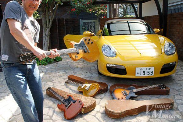 ポルシェの前でギターを振り回すTaddy